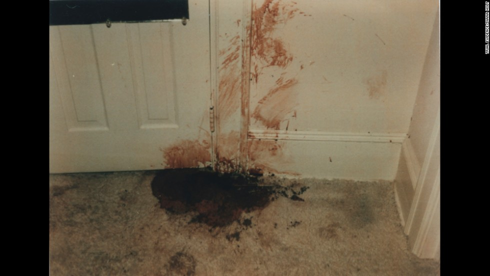 Holloway said he found her bloodied and battered body stuffed in this bedroom closet. Prosecutors said Elmore forced his way into the house through the back door to commit a robbery. An attack occurred in the kitchen, where Edwards suffered a blow so powerful that a denture plate flew out of her mouth, according to testimony.