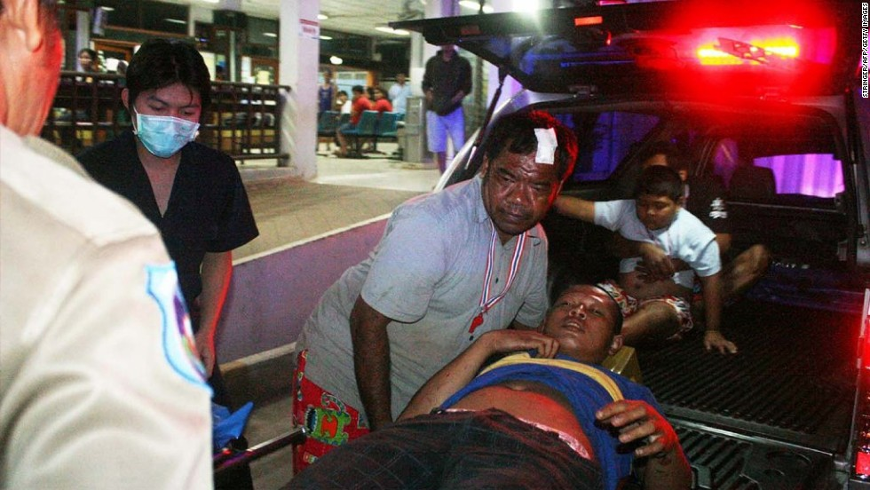 Hospital workers evacuate an injured villager after an attack near an anti-government rally in Khao Saming in Thailand's Trat province on Sunday, February 23. A 5-year-old girl was killed and more than 30 others wounded when attackers sprayed bullets on an anti-government rally in eastern Thailand, police said.