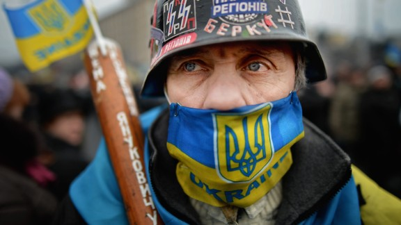 KIEV, UKRAINE - FEBRUARY 23: A masked man stands in independence square on February 23, 2014 in Kiev, Ukraine. Prime Minister Yanukovych is said to have left Kiev for a eastern stronghold as the country's parliament voted to remove Yanukovych from office and call for new elections. (Photo by Jeff J Mitchell/Getty Images)
