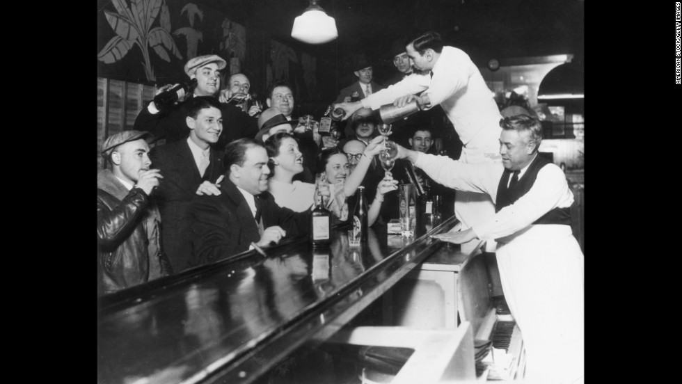 Bartenders at Sloppy Joe's bar in downtown Chicago pour a round of drinks in 1933 to celebrate the repeal of the 18th Amendment and the end of the Prohibition era.
