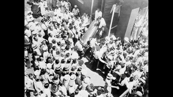 Famous bank robber John Dillinger met his demise at Chicago's Biograph Theater, where he attended a performance with Anna Sage, a friend and brothel madam and -- unbeknownst to Dillinger -- an FBI informant. Dillinger was shot and killed after he emerged from the theater on July 22, 1934. This aerial view shows Dillinger's body being taken from a funeral home in Chicago two days after his death.