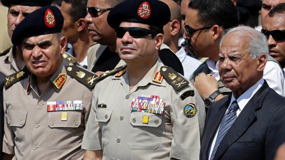 [FILE] Egypt's Defense Minister Gen. Abdel-Fattah el-Sissi, center, Egyptian Prime Minister Hazem el-Beblawi, right, and army's Chief of Staff Lt. Gen. Sedki Sobhi, left, attend the funeral of Giza Police Gen. Nabil Farrag in Cairo, Egypt.