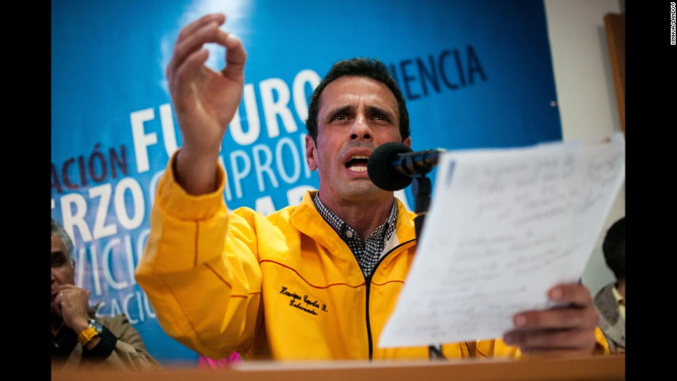 Henrique Capriles, an opposition leader and governor of the Venezuelan state of Miranda, joins in a news conference February 24 in Caracas. Opposition leaders and government officials blame each other for the unrest, and both sides show no sign of backing down.