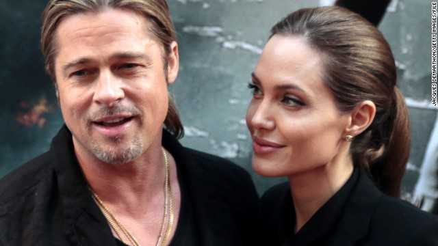 US actors Brad Pitt (L) and Angelina Jolie pose upon their arrival for the premiere of 'World War Z' on the Champs Elysees Avenue in Paris on June 3, 2013. AFP PHOTO / JACQUES DEMARTHON (Photo credit should read JACQUES DEMARTHON/AFP/Getty Images)