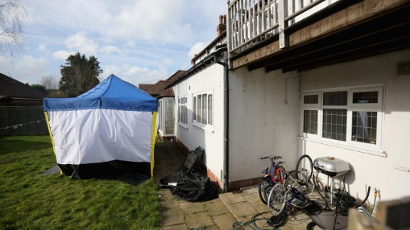 A police forensic tent sits in the garden of Moazzam Begg