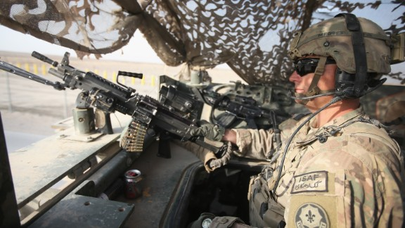 KANDAHAR, AFGHANISTAN - FEBRUARY 25: SGT Matt Farkas from Sierra Vista, Arizona a medic with the U.S. Army's 4th squadron 2d Cavalry Regiment mans a machinegun at the back of a Stryker during a patrol on February 25, 2014 near Kandahar, Afghanistan. Fourth squadron 2d Cavalry Regiment is responsible for defending Kandahar Airfield against rocket attacks from insurgents. (Photo by Scott Olson/Getty Images)