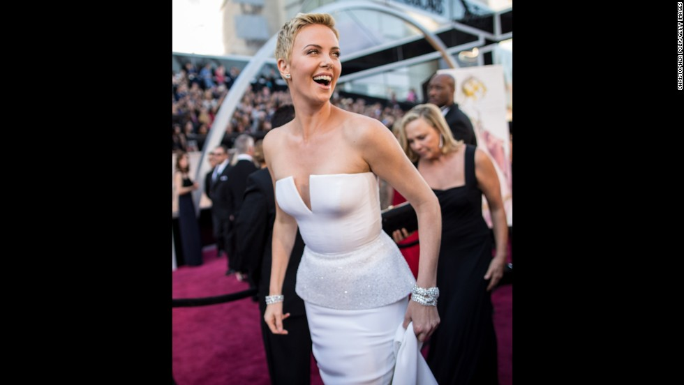 "Some actresses rely on their hair to help tell their fashion story at the Oscars, but Charlize Theron didn't need much assistance in 2013. The actress, who'd cut her locks super-short to film ""Mad Max: Fury Road,"" rocked the haircut at the awards show with a white strapless dress that was just as architecturally chic."