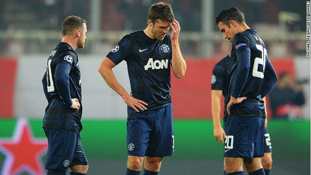 PIRAEUS, GREECE - FEBRUARY 25: (L-R) Wayne Rooney, Michael Carrick and Robin van Persie of Manchester United react as they restart the game after conceding the first goal during the UEFA Champions League Round of 16 first leg match between Olympiacos FC and Manchester United at Karaiskakis Stadium on February 25, 2014 in Piraeus, Greece. (Photo by Michael Regan/Getty Images)