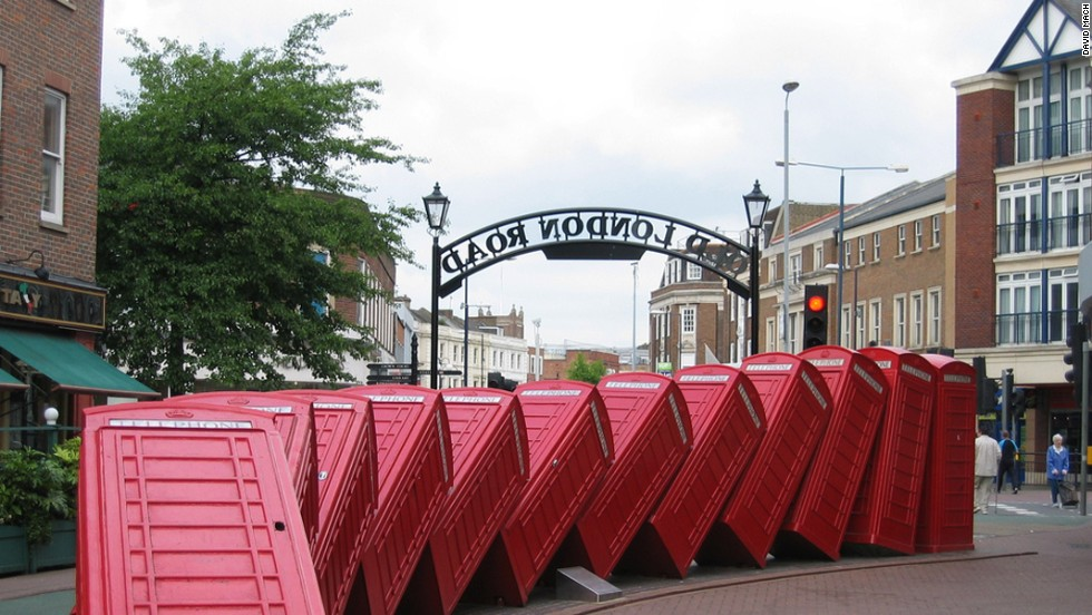 "A domino effect appears to occur with his ""Out of Order"" artwork in London, of old red phone boxes piled up on top of one another."