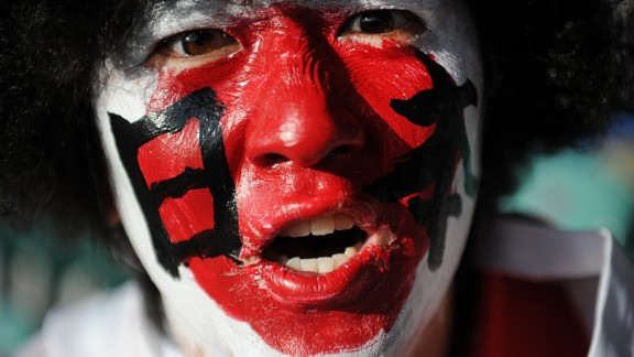 """Fervor for rugby in Japan at all levels is on the rise -- here a fan supports the """"Cherry Blossoms"""" during a 2011 Rugby World Cup match in New Zealand."""