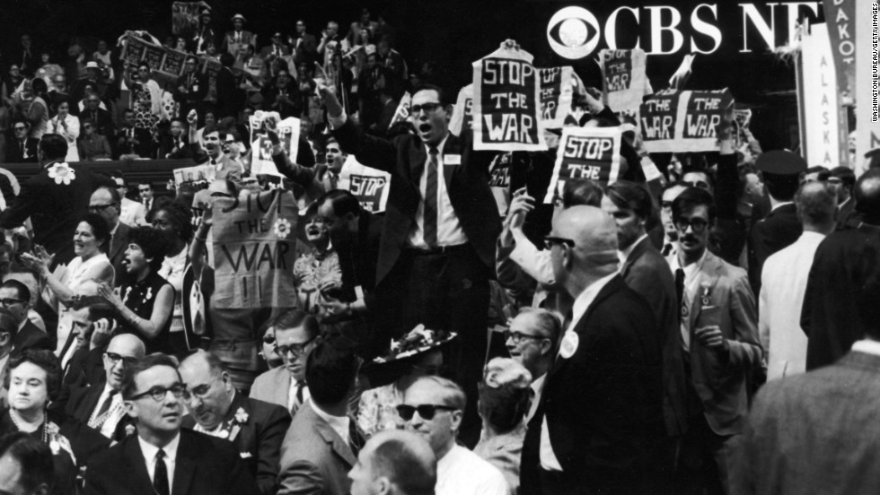 Members of the New York delegation protest against the Vietnam War during the 1968 Democratic National Convention held in Chicago. Outside, riots erupted, with tens of thousands of Vietnam War protesters clashing with Chicago police and National Guard forces.