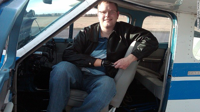 Brian Thomas, 30, was able to return to the cockpit 18 months after losing his right hand and parts of both feet.