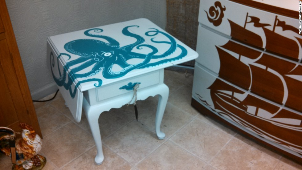 Kristie Rackliffe's reimagined octopus table and boat dresser in her booth at the Queen of Hearts antique mall.
