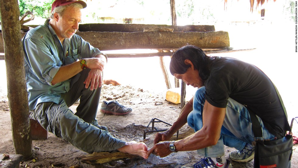 Dr. Mark Plotkin is treated and cured of a foot injury by Amasina, paramount shaman of the Trio tribe in southwestern Suriname.