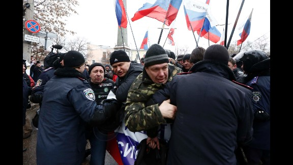 Police intervene as Russian supporters gather in front of the parliament building in Simferopol on February 27.
