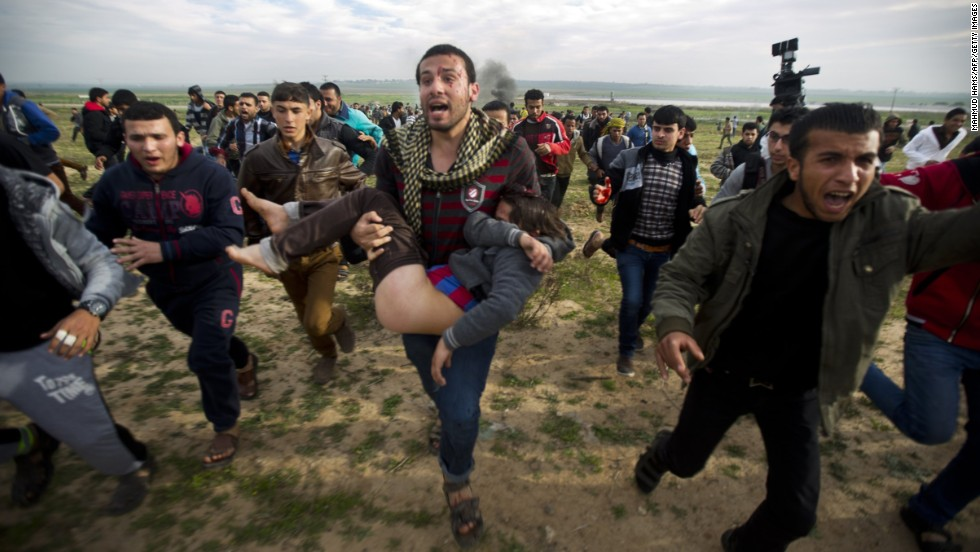 Palestinian civilians carry an injured boy during clashes with Israeli security forces near the eastern border of Gaza on Friday, February 21.