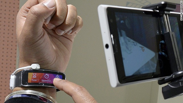 A visitor takes a picture of the new Samsung Galaxy Fit during the 2014 Mobile World Congress in Barcelona on February 25, 2014 The Mobile World Congress runs from the 24 to 27 February where participants and visitors alike can attend conferences, network, discover cutting-edge products and technologies at among the 1,700 exhibitors as well as seek industry opportunities and make deals. AFP PHOTO/LLUIS GENELLUIS GENE/AFP/Getty Images