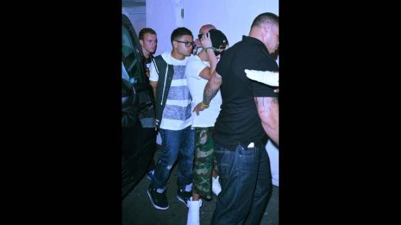 """<strong>14. Started sampling the nightlife</strong>: According to the rumor mill, <a href=""""http://gawker.com/justin-bieber-licks-strippers-nipple-1513933703"""" target=""""_blank"""" target=""""_blank"""">Justin Bieber enjoys strippers</a>, and <a href=""""http://www.tmz.com/2014/01/21/justin-bieber-miami-strip-club-king-of-diamonds-tmz-tv/"""" target=""""_blank"""" target=""""_blank"""">he's a very, very big tipper</a>. Whether he actually visits strip clubs or not -- and he wasn't here; this picture was taken outside of Miami's Mansion night club -- isn't really the point. As in the case of Mariah Yeater, the woman who made the Bieber-daddy claim, just the insinuation that he's a fan of """"adult entertainment"""" is enough to distance himself from his teen star reputation."""