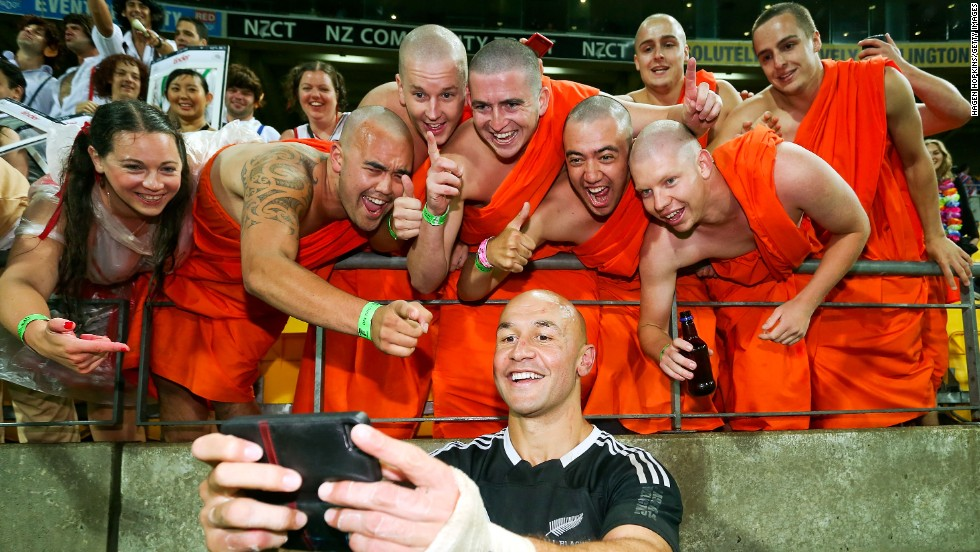 New Zealand captain D.J. Forbes celebrates with fans dressed as the Dalai Lama after his team won the final of the Wellington Sevens in February 2014.