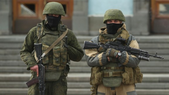 Heavily armed troops, displaying no identifying insignia and who were mingling with local pro-Russian militants, stand guard outside a local government building in Simferopol on March 2.