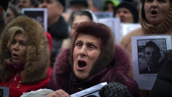 Demonstrators shout during a rally in Kiev