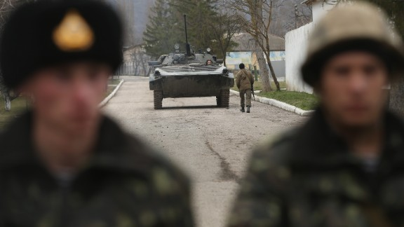A Ukrainian army tank withdraws from standing just inside the gate with Ukrainian soldiers at a Ukrainian military base that was surrounded by several hundred Russian-speaking soldiers in Crimea on March 2, 2014 in Perevanie, Ukraine. Several hundred heavily-armed soldiers not displaying any idenifying insignia took up positions outside the base and parked several dozen vehicles, mostly trucks and patrol cars, nearby. The new government of Ukraine has appealed to the United Nations Security Council for help against growing Russian intervention in Crimea, where thousands of Russian troops reportedly arrived in recent days at Russian military bases there and also occupy key government and other installations. World leaders are scrambling to persuade Russian President Vladimir Putin to refrain from further escalation in Ukraine. Ukraine has put its armed forces on combat alert.