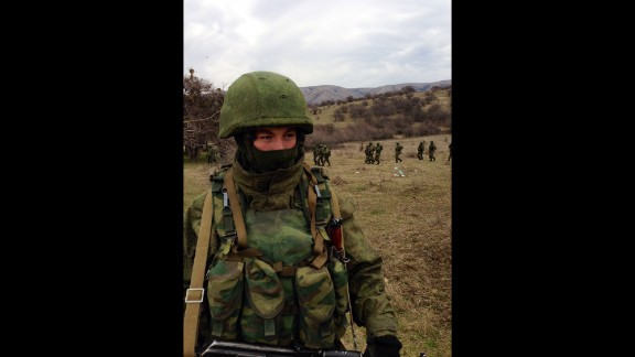 """PEREVALNOYE BASE, UKRAINE:  """"Outside Ukrainian base in Crimea (March 2), tight-lipped but obviously Russian marines deploy around perimeter as Ukrainian soldiers inside vow not to surrender."""" - CNN's Ben Wedeman.  Follow Ben on Instagram at instagram.com/bcwedeman."""