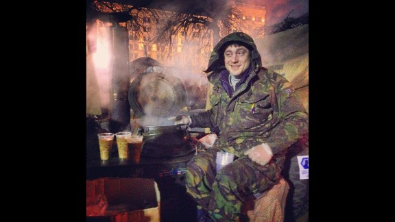 """KIEV, UKRAINE:  """"27-year old Bogdan sits on top of his Russian-made soup kitchen in Indepence -- or Maidan -- Square on March 2. He's been sitting there for the last three months serving delicious Ukrainian grechaniy soup. It's made of buckwheat, lentil, coriander and beef. Amazing taste."""" - CNN's Christian Streib.  Follow Christian on Instagram at instagram.com/christianstreibcnn."""