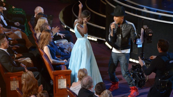 """Nyong'o dances with Pharrell Williams during his performance of """"Happy."""""""