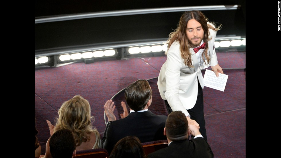 "Jared Leto shakes hands with an audience member after winning the best supporting actor Oscar for his role in ""Dallas Buyers Club."""