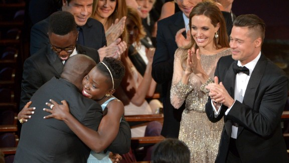 """Lupita Nyong'o hugs McQueen after winning best supporting actress for her role in """"12 Years a Slave."""""""