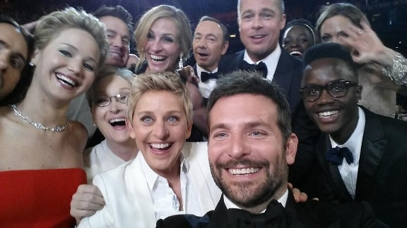 "Academy Awards host Ellen DeGeneres takes a moment during the show to orchestrate a selfie with a group of stars. Bradley Cooper, seen in the foreground, was holding the phone at the time. ""If only Bradley"