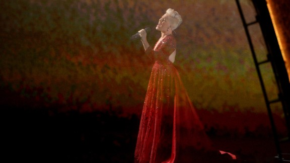 """Pink sings """"Over the Rainbow"""" while scenes from """"The Wizard of Oz"""" are projected in the background. The performance was a tribute to the film's 75th anniversary."""
