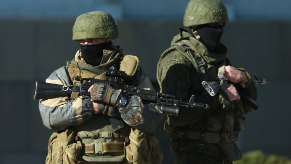 Heavily-armed troops displaying no identifying insignia and who were mingling with local pro-Russian militants stand guard outside a local government building on March 3, 2014 in Simferopol, Ukraine.