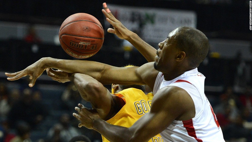 Emilio Parks of Johnson C. Smith University is fouled by Winston-Salem State defender Brian Okam, right, in the CIAA Tournament semifinals at Time Warner Cable Arena in Charlotte, North Carolina, on Friday, February 28.