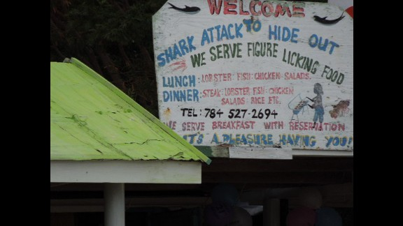 """""""Several mental images came to mind, none very appetizing,"""" when Robert Tanner saw this sign for """"figure licking"""" food at a restaurant on Chatham Bay, Union Island, in the Grenadines."""