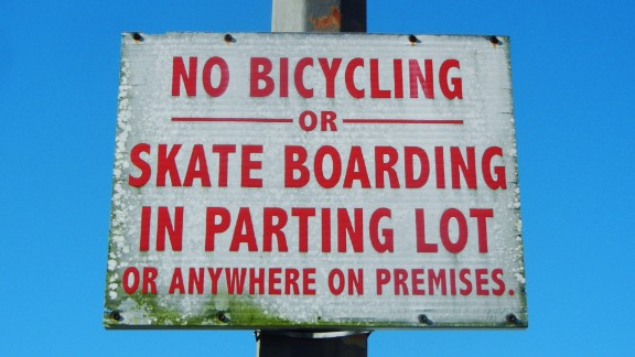 """What is allowed in a """"parting"""" lot? Kate VanHook in Orlando says she's """"confused and amazed at how official signs for businesses, streets, products, etc. make it past quality control."""""""