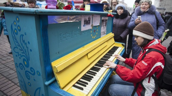"""A young girl plays <a href=""""http://ireport.cnn.com/docs/DOC-1098749"""">piano</a> in downtown Kiev 10 days after protests there."""