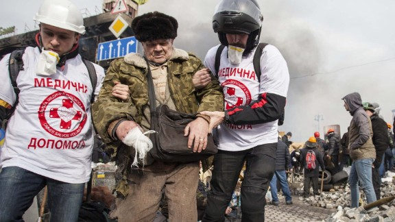 """Mikhaluk said that since the evening of February 18, a once peaceful <a href=""""http://ireport.cnn.com/docs/DOC-1088436"""">Euromaidan</a> had become a battlefield."""