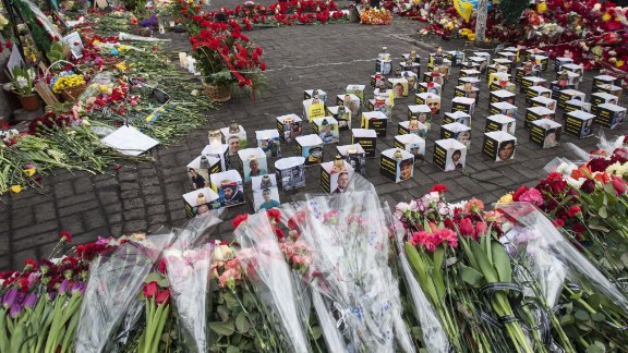 """""""People are still coming with <a href=""""http://ireport.cnn.com/docs/DOC-1098749"""">flowers</a> and grieving for the heroes who laid their lives for free Ukraine. The streets are like rivers of flowers,'"""" Mikhaluk said."""