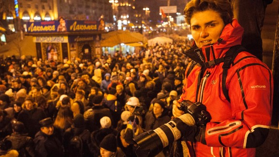 """<a href=""""http://ireport.cnn.com/people/MaiaKiev"""">Maia Mikhaluk</a> is a freelance photographer and one of the protesters who has been documenting the unrest in Ukraine since February 18. In these photos, she offers us a glimpse of the faces inside Maidan, the central square in Kiev where the majority of the demonstrations took place."""
