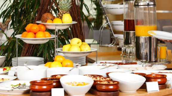 In a Cornell University study published in the journal PLoS One, researchers observed people at two separate breakfast buffet lines that featured the same seven items: cheesy eggs, potatoes, bacon, cinnamon rolls, low-fat granola, low-fat yogurt and fruit. One line presented the foods from healthiest to least-healthy, while the other line had the order reversed.   Regardless of which line they passed through, more than 75% of diners put the first food they saw on their plates; the first three foods they encountered in the buffet made up two-thirds of all the foods they added to their plate. So take a stroll around the buffet or dinner table before you serve yourself, suggests Young.   Health.com: 20 best foods to eat for breakfast