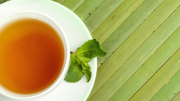 """Many people have trained themselves to expect a sweet treat at the end of a meal, says Blatner. Swap in a healthier ritual after meals to signal that you're done eating. She recommends brewing a flavorful decaf tea like peppermint, cinnamon, chocolate or one of your favorite fruity varieties for a low- or-no-calorie sweet-tooth satisfier. <br /><br /><em>This article originally appeared on </em><a href=""""http://www.health.com/health/gallery/0,,20769037,00.html"""" target=""""_blank"""" target=""""_blank""""><em>Health.com</em></a><em>. </em>"""