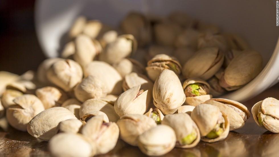 "Here's another way to slow down your eating: munch on foods that require shelling, peeling or individual unwrapping, suggests Blatner. Oranges, edamame and pistachios in their shells are healthy options. <br /><br /><a href=""http://www.health.com/health/gallery/0,,20516496,00.html"" target=""_blank"">Health.com: How to lose 12 pounds in a month </a><br />"