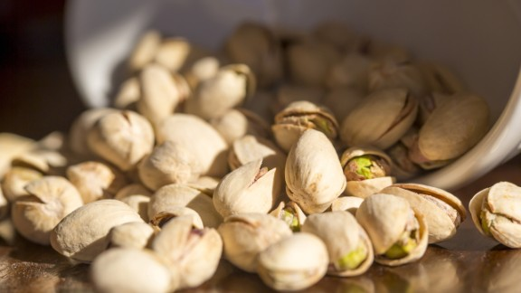"""Here's another way to slow down your eating: munch on foods that require shelling, peeling or individual unwrapping, suggests Blatner. Oranges, edamame and pistachios in their shells are healthy options. <br /><br /><a href=""""http://www.health.com/health/gallery/0,,20516496,00.html"""" target=""""_blank"""" target=""""_blank"""">Health.com: How to lose 12 pounds in a month </a><br />"""