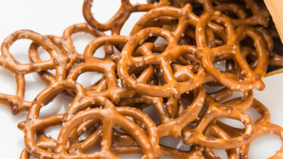 When you sit down with a bag of chips, do you really know how many you're eating? Researchers from Cornell University sought to answer this question in a study and found that people ate 50% more chips when they were given no visual cues as to how large a portion should be. So if you buy a bag of pretzels or tin of nuts that contains 10 servings, divide the contents of the container into 10 smaller baggies ahead of time.   Health.com: How to lose weight and keep it off for good