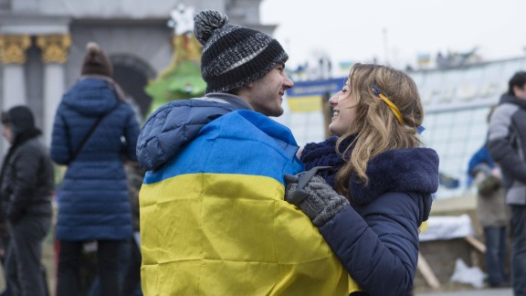 A young couple embraces in Kiev's main square where people have gathered to show their support for their country.