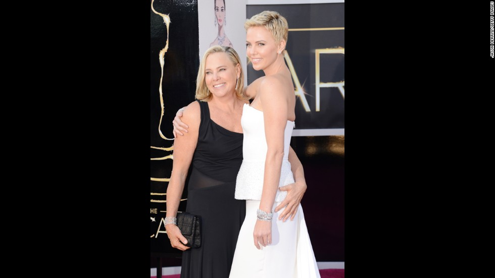Charlize Theron, right, and mother Gerda Maritz arrive at the Oscars on February 24, 2013, in Hollywood, California.