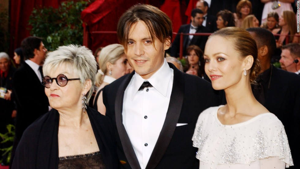 Johnny Depp, his mother Betty Sue Palmer, left, and girlfriend Vanessa Paradis attend the 76th Annual Academy Awards on February 29, 2004, in Hollywood, California.