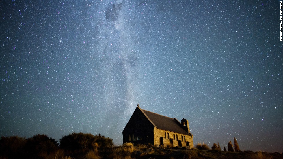 <strong>Aoraki Mackenzie Dark Sky Reserve (New Zealand):</strong> Looking south from Lake Tekapo, on the South Island in New Zealand, you can see the Milky Way stretching over the Church of the Good Shepherd. The Southern Cross and the Coal Sack Nebula are visible near the top of the image.